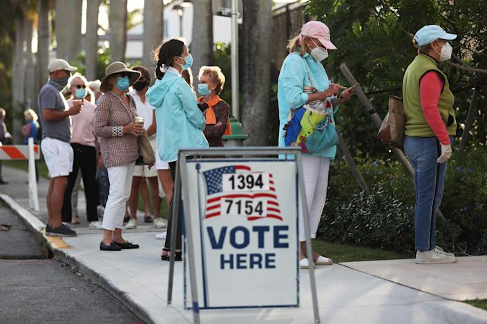PALM BEACH, FLORIDA- November 3: People stand in line to vote at the Morton Recreation Center and Barbara Mandel on November 3, 2020 in Palm Beach, Florida.  After a record early turnout of voters, Americans arrive at the polls on the last day to vote for incumbent US President Donald Trump or Democratic candidate Joe Biden in the 2020 presidential election. (Photo by Joe Raedle / Getty Images)