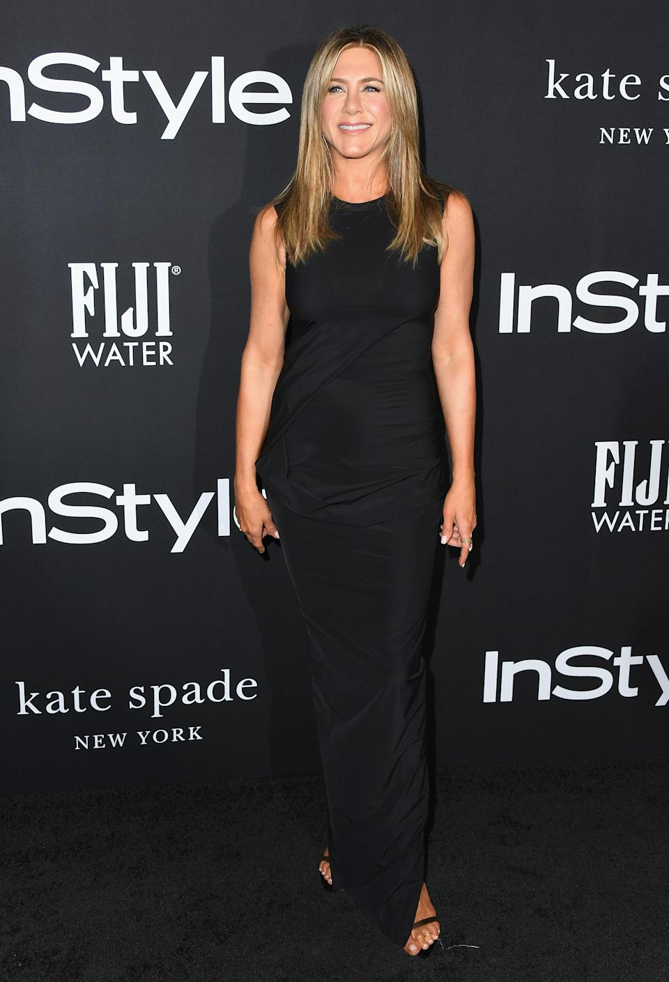 <p>The ultimate queen of the LBD, Aniston arrived to present her longtime hair stylist, Chris McMillan with an award. </p>