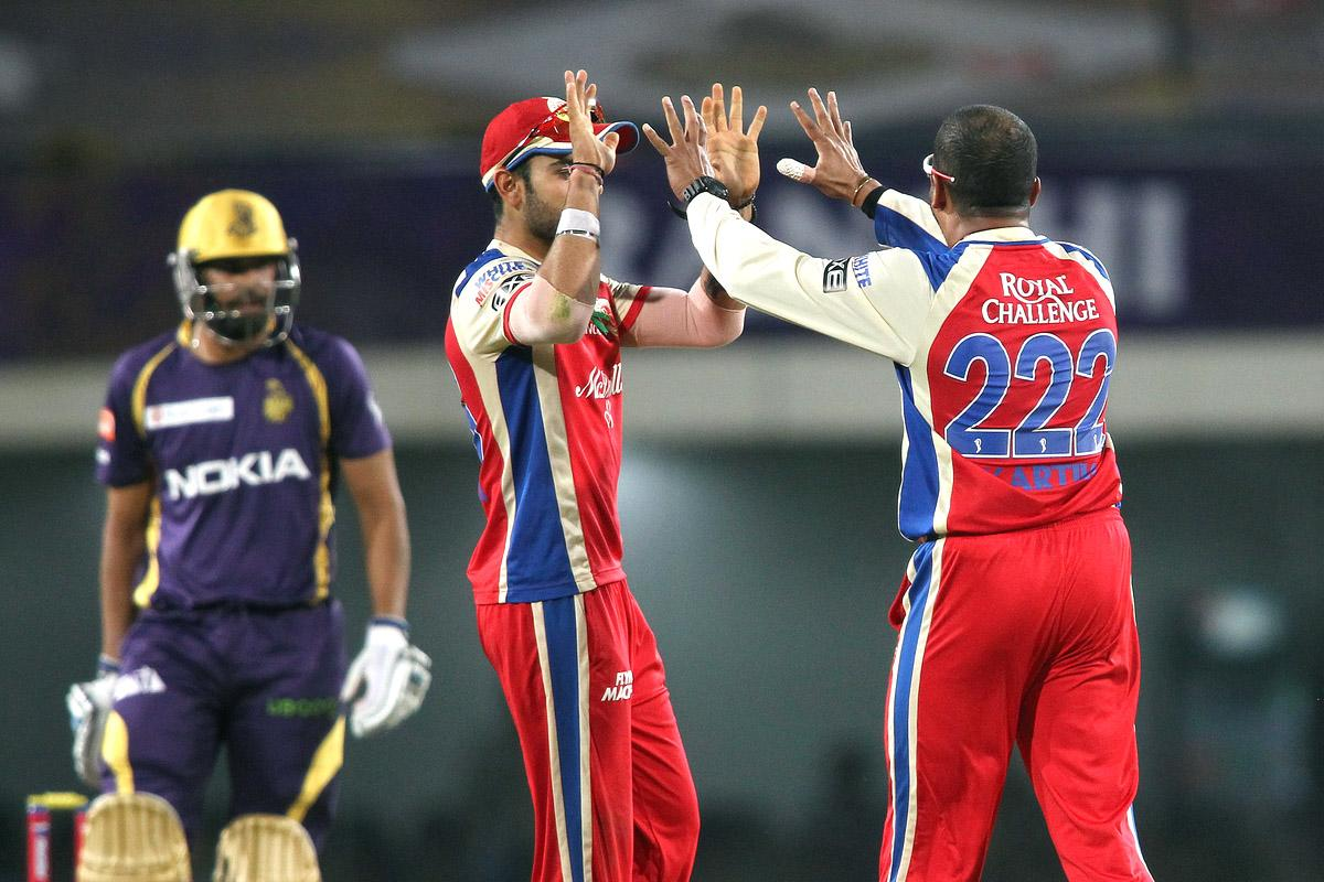 Royal Challengers Bangalore captain Virat Kohli congratulates Murali Kartik of the Royal Challengers Bangalore for getting Yusuf Pathan of Kolkata Knight Riders wicket during match 60 of the Pepsi Indian Premier League between The Kolkata Knight Riders and the Royal Challengers Bangalore held at the JSCA International Stadium Complex, Ranchi, India on the 12th May 2013. (BCCI)