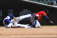 Chicago Cubs second baseman David Bote, left, is tagged out by Atlanta Braves second baseman Ozzie Albiies during the sixth inning of a baseball game Friday, April 16, 2021, in Chicago. (AP Photo/Matt Marton)