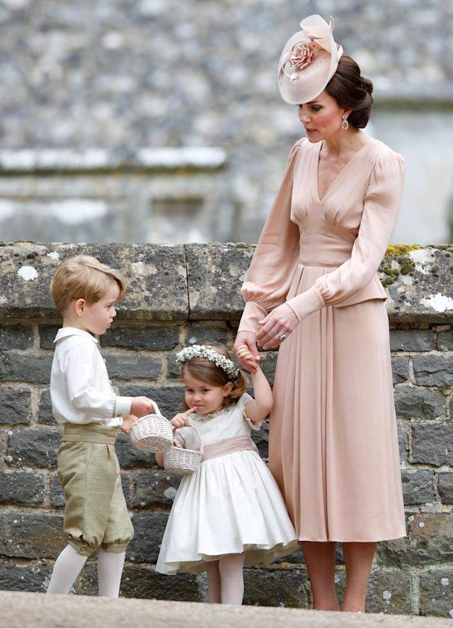 Prince George and Princess Charlotte wore bespoke outfits for their aunt Pippa Middleton's big day in May 2017. (Photo: Getty Images)