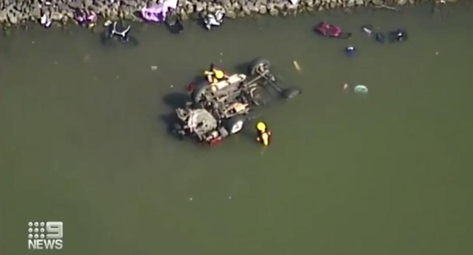 The submerged car in Wyaralong Dam. It was carrying six people on board.