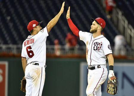 Jul 22, 2018; Washington, DC, USA; Washington Nationals right fielder Bryce Harper (34) and third baseman Anthony Rendon (6) celebrate after defeating the Atlanta Braves at Nationals Park. Mandatory Credit: Brad Mills-USA TODAY Sports