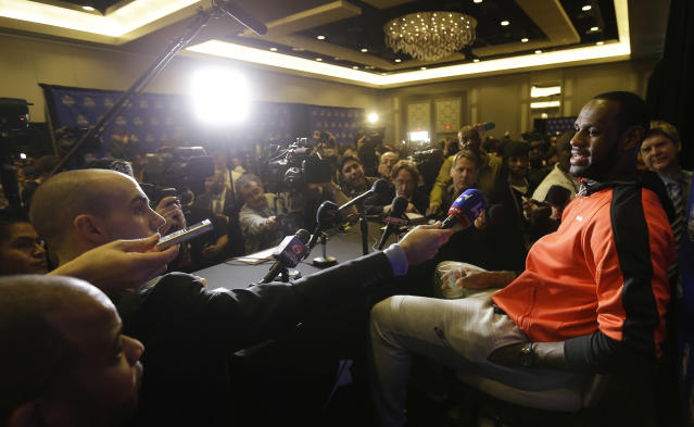 The Miami Heat's LeBron James speaks with reporters during the NBA All Star basketball news conference, Friday, Feb. 14, 2014, in New Orleans. (AP Photo/Gerald Herbert)