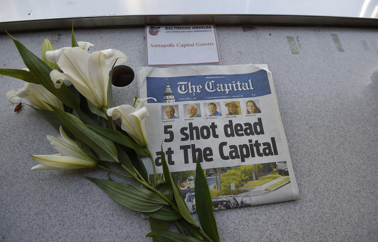 A memorial for the five Capital Gazette employees killed during Thursday's mass shooting is displayed in the Camden Yards press box. (AP)