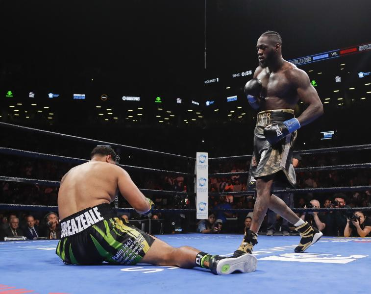 Deontay Wilder, right, knocks down Dominic Breazeale during the first round of a WBC heavyweight championship boxing match Saturday, May 18, 2019, in New York. Wilder stopped Breazeale in the first round.(AP Photo/Frank Franklin II)