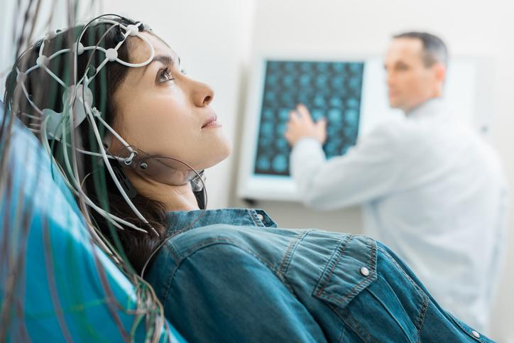 A woman getting an EEG.