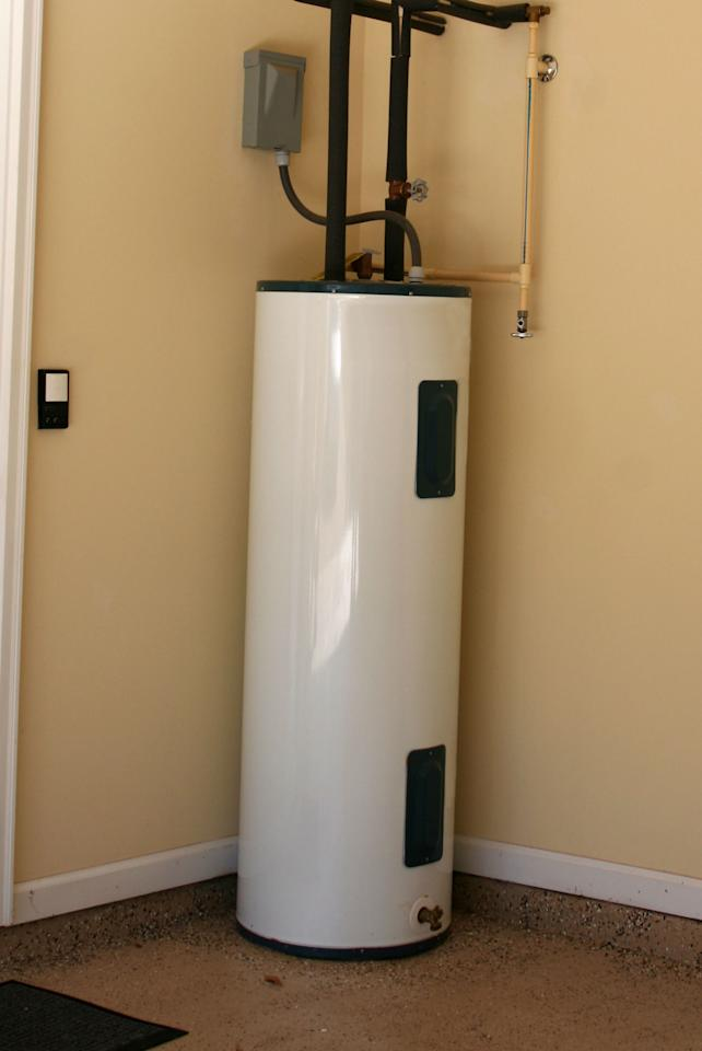 <p>Your electric water heater draws more electricity than almost anything else in your house. Take advantage of most electric companies' off-peak reduced rates by putting your electric heater on a timer that turns off at 6:00 a.m., for example, and clicks back on at 6:00 p.m. Most heaters are big enough and have enough insulation to maintain adequate hot water throughout the day without being switched on. But for those occasions when you want to take a leisurely midday bath, just press a button and it instantly turns the water heater back on.</p>