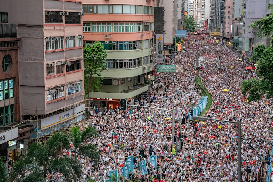 Protesters march on a street during a rally against a controversial extradition law proposal. Photo: Anthony Kwan/Getty Images