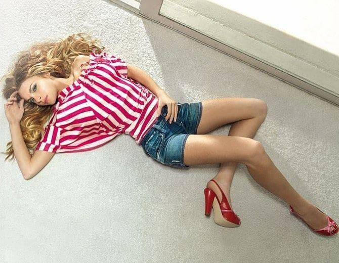 Lindsay Lohan poses in heels and shorts
