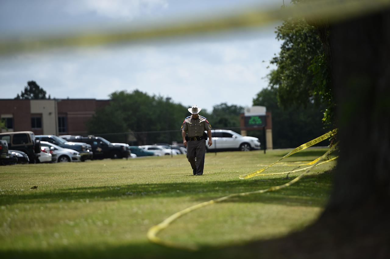 <p>Police officers patrol outside Santa Fe High School on May 19, 2018, in Santa Fe, Texas. (Photo: Brendan Smialowski/AFP/Getty Images) </p>