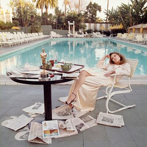 O'Neill's celebrated portrait of the American actress Faye Dunaway taking breakfast by the pool with the day's newspapers at the Beverley Hills Hotel, 29th March 1977, the night after she won the Oscar for Best Actress in a Leading Role for 'Network'. - Credit: Terry O'Neill / Iconic Images