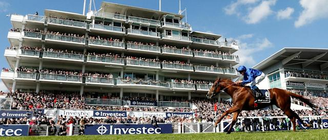 Horse Racing - Derby Festival - Epsom Downs Racecourse, Epsom, Britain - June 2, 2018 Masar ridden by William Buick in action as he wins the 4.30 Investec Derby Action Images via Reuters/Andrew Boyers
