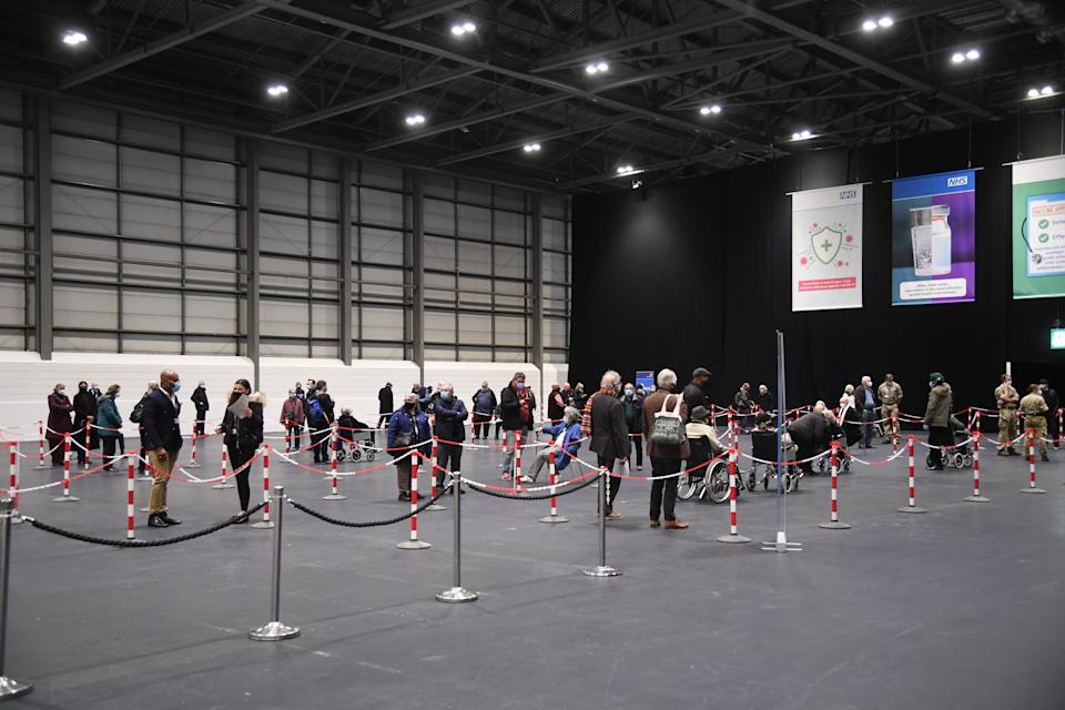 People queuing to receive a Covid-19 vaccine at the NHS Nightingale facility at the Excel Centre, London, one of the seven mass vaccination centres now opened to the general public as the government continues to ramp up the vaccination programme against Covid-19.