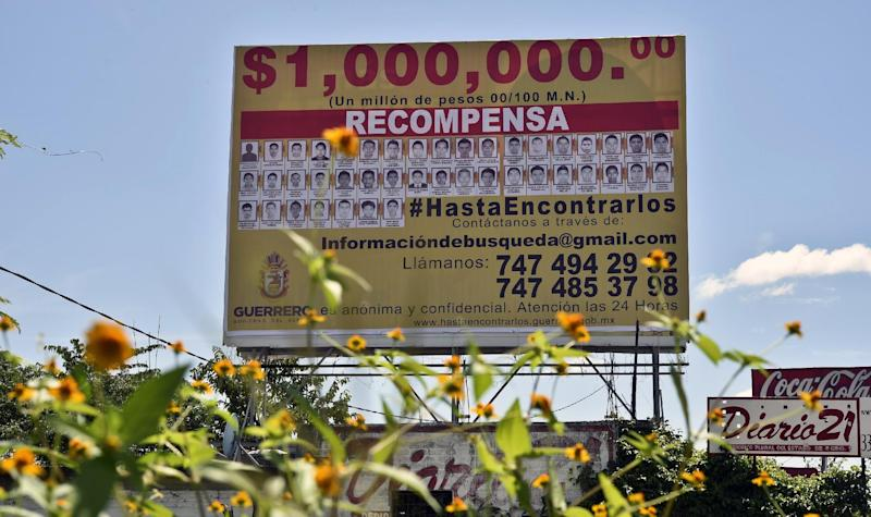 A view of a giant billboard offering a million Mexican pesos reward for information on the 43 missing students, on display along the Chilpancingo-Iguala highway in Iguala, Mexico on October 12, 2014