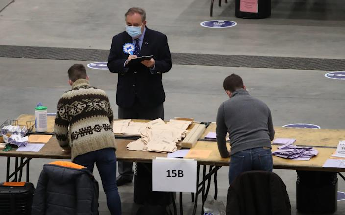 Alex Salmond watches votes being counted for the Scottish parliamentary elections - PA