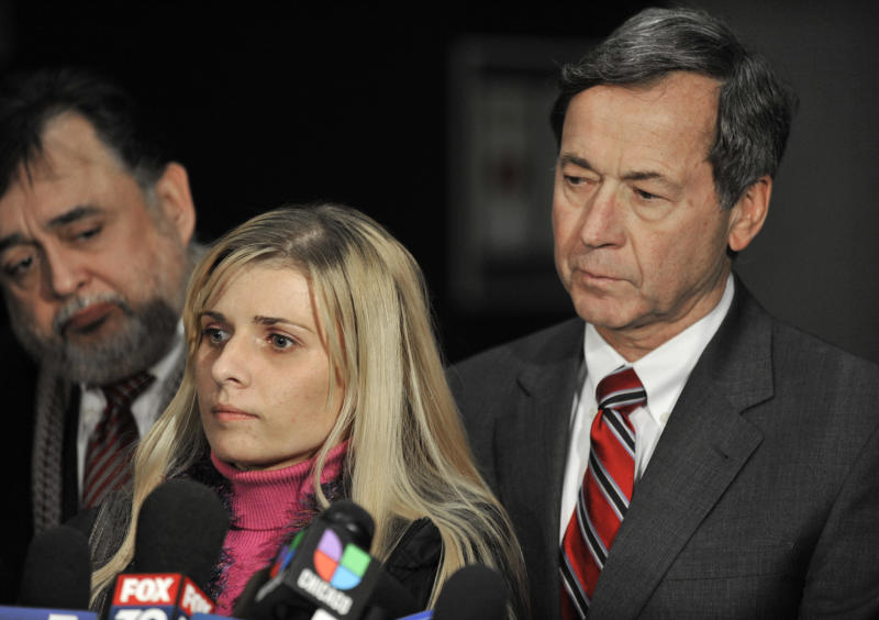 Bartender Karolina Obrycka, left, talks to the media while her attorney Terry Ekl, right, looks on during a news conference in Chicago on Tuesday, Nov. 13, 2012. Jurors awarded $850,000 in damages to Obrycka, who was beaten in February 2007 by off-duty Chicago police officer Anthony Abbate, who was admittedly drunk at the time. Surveillance video of the hulking Abbate pushing Obrycka to the ground behind the bar at Jesse's Shortstop Inn, then repeatedly punching and kicking her went viral online. (AP Photo/Paul Beaty)