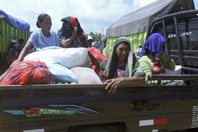 <p>Villagers who evacuated from their homes on the slope of Mount Agung sit in a truck upon arrival at a temporary shelter in Klungkung, Bali, Indonesia, Sept. 23, 2017. Thousands of villagers on the Indonesian resort island of Bali are sheltering in sports centers, village halls and with relatives, fearing Mount Agung will erupt for the first time in more than half a century. (AP Photo/Firdia Lisnawati) </p>