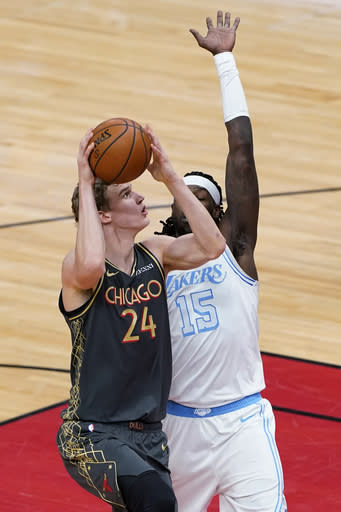 Chicago Bulls forward Lauri Markkanen, left, shoots against Los Angeles Lakers center Montrezl Harrell during the first half of an NBA basketball game in Chicago, Saturday, Jan. 23, 2021. (AP Photo/Nam Y. Huh)