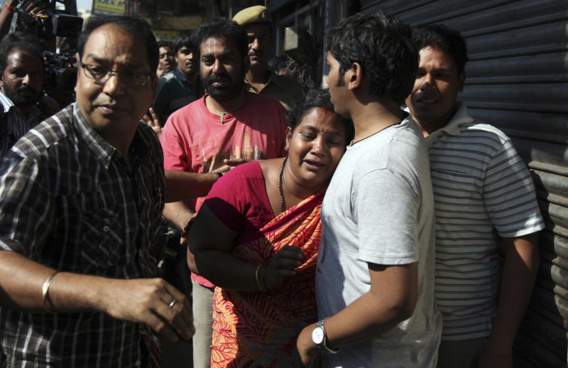 Relatives of passengers wail outside the office of a private bus operator, Jabbar Travels in Hyderabad, Andhra Pradesh state, India, Wednesday, Oct. 30, 2013 after their bus crashed into a highway barrier and erupted in flames early Wednesday. According to officials, many of the passengers were burned alive in the inferno in the accident. (AP Photo/Mahesh Kumar A.)