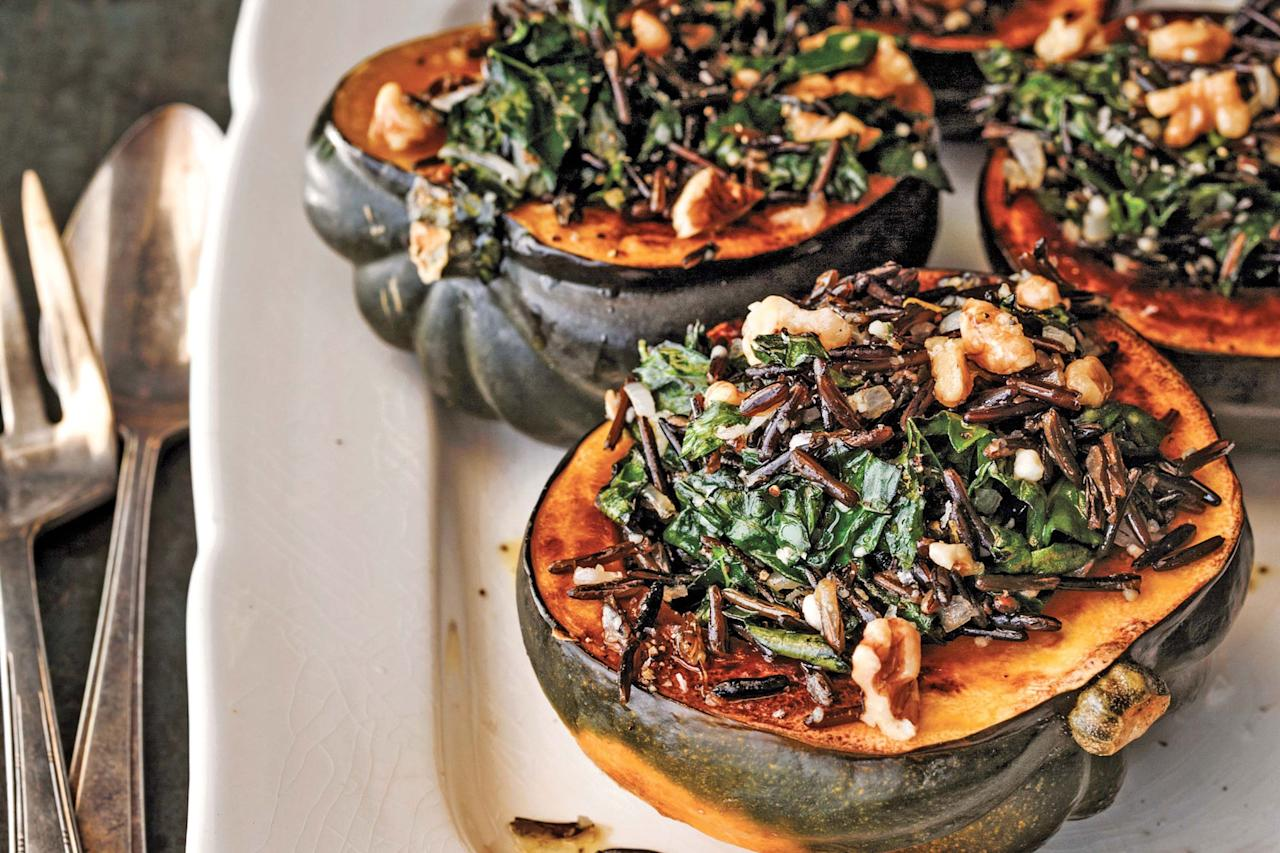 """Nutty, salty Pecorino Romano cheese gives this gorgeous stuffed squash a boost. Wild rice and toasted walnuts add chewy texture, while lemon and a little Dijon mustard keep things bright. <a href=""""https://www.epicurious.com/recipes/food/views/kale-and-wild-rice-stuffed-winter-squash?mbid=synd_yahoo_rss"""">See recipe.</a>"""