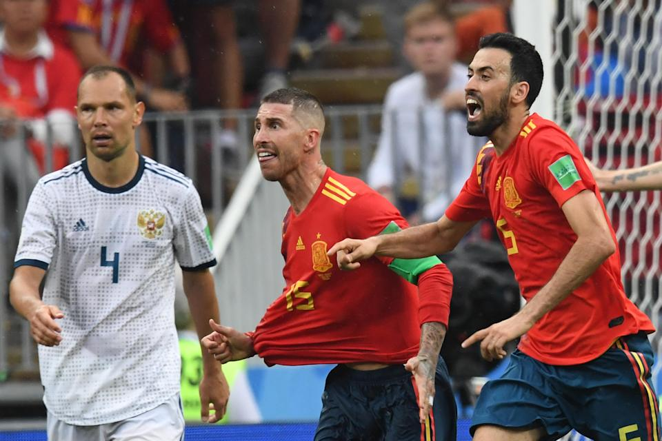 Sergio Ramos and Sergio Busquets complain to the referee during Spain's Round of 16 World Cup match against Russia. (Getty)