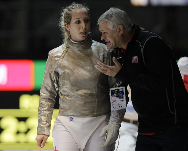 Mariel Zagunis, of the United States, talks with her coach after losing a women's individual sabre final match against Russia's Sophia Velikaia at the World Fencing Championship in Catania, Italy, Wednesday, Oct. 12, 2011. (AP Photo/Antonio Calanni)