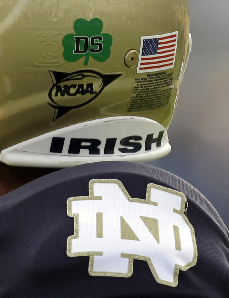 "FILE - In this Oct. 30, 2010, file photo, Notre Dame kicker Brandon Walker wears a ""DS"" sticker honoring Declan Sullivan before the start of a NCAA college football game against Tulsa in South Bend, Ind.  Sullivan would have been in his element this weekend, video camera at hand, adding his own sly observations about the team for which he grew up rooting and served as a film assistant until his tragic death in October 2010.  (AP Photo/Michael Conroy, File)"