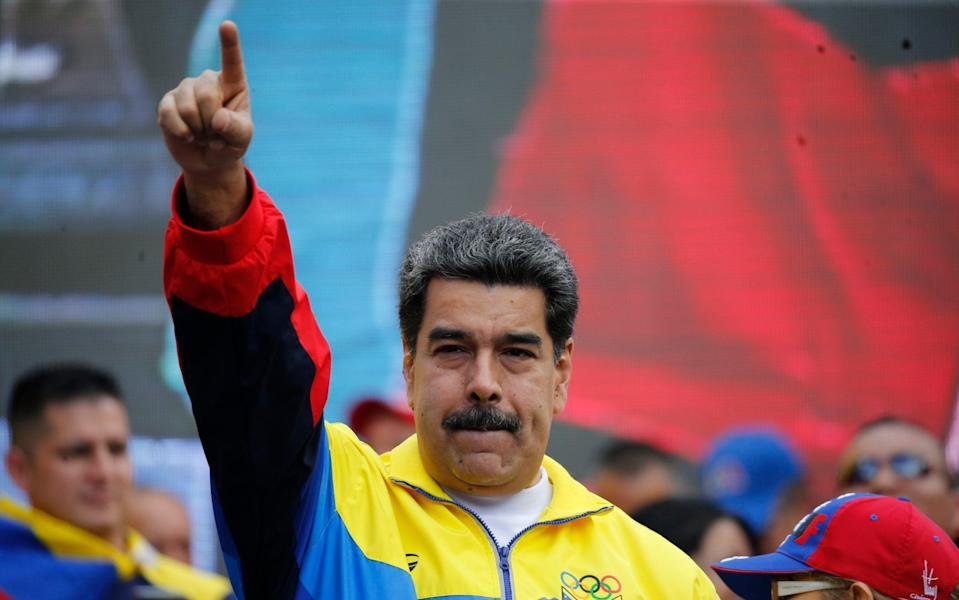 Venezuela's President Nicolas Maduro at a rally in Caracas condemning the economic sanctions imposed by the US - Ariana Cubillos/AP