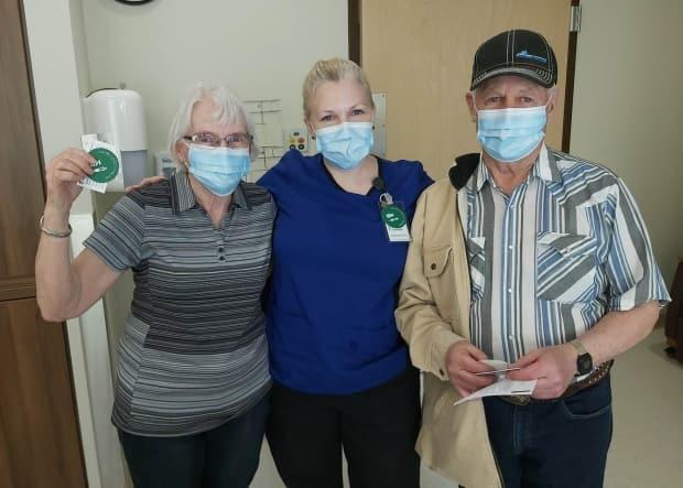 Lynette Brown immunized her parents, Tom and Marianna Eremenko, at the pop-up COVID-19 vaccination clinic in Maple Creek, Sask., on March 17. (Submitted by Lynette Brown - image credit)