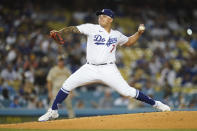 Los Angeles Dodgers starting pitcher Julio Urias (7) throws during the second inning of a baseball game against the San Diego Padres Friday, Sept. 10, 2021, in Los Angeles. (AP Photo/Ashley Landis)