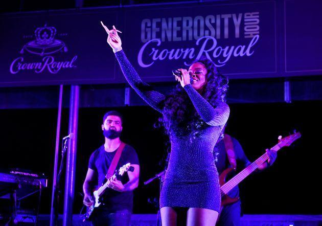 R&B singer-songwriter Ari Lennox performs at the Crown Royal #GenerosityHour to give back to Washington Heights hospitality workers at The Hudson on June 15 in New York City. (Photo: Noam Galai via Getty Images for Crown Royal)