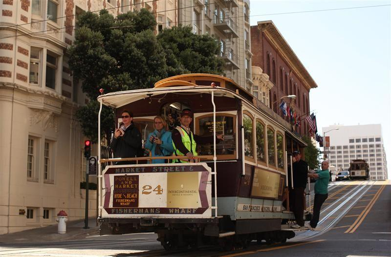 A cable car on the Powell Street line crosses California Street in San Francisco, California.