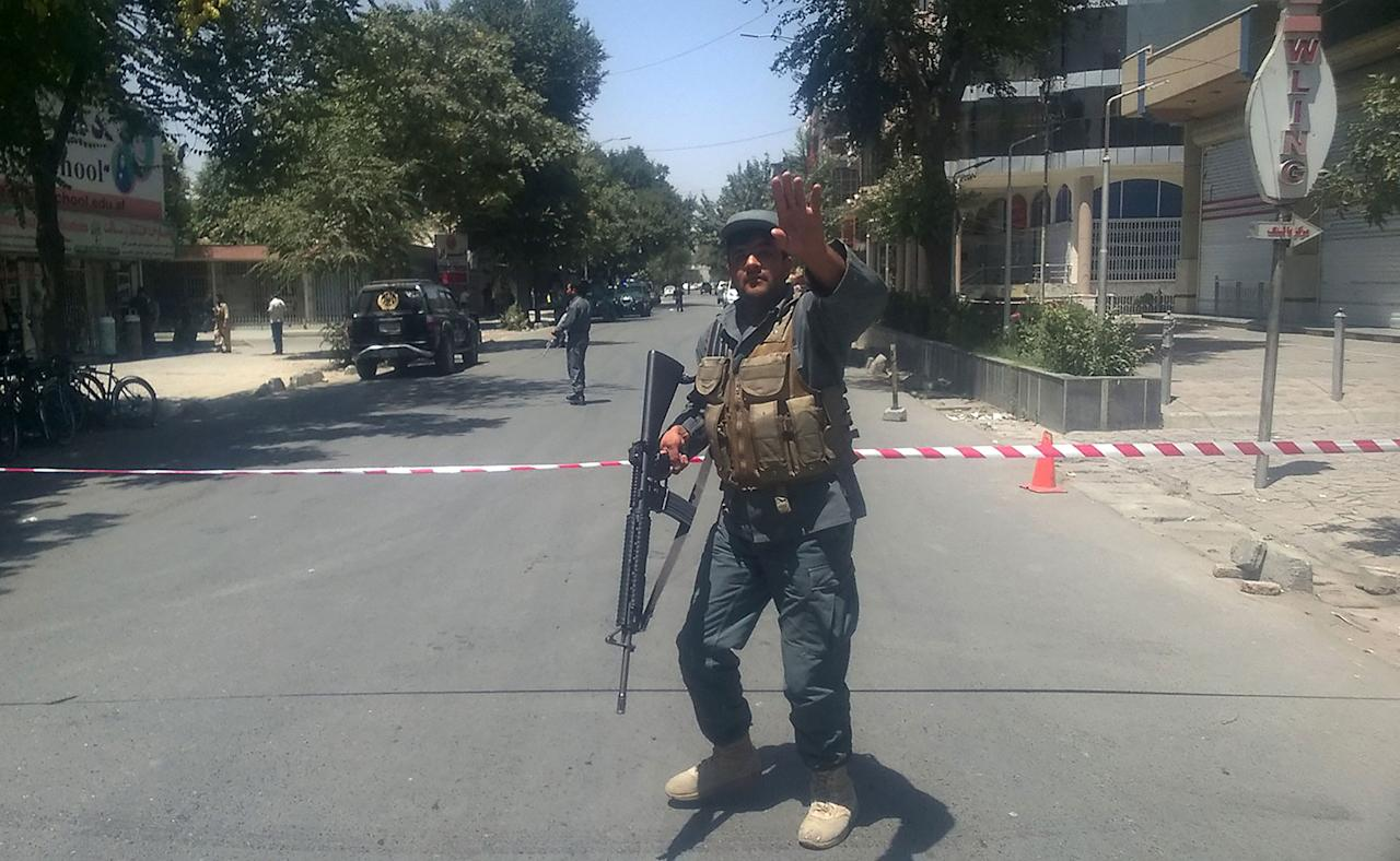 "<p>An Afghan policeman sets up a perimeter at the site of an explosion in Kabul on July 31, 2017.<br /> A series of explosions and the sound of gunfire shook the Afghan capital on July 31, with a security source telling AFP that a suicide bomber had blown himself up in front of the Iraqi embassy. ""Civilians are being evacuated"" from the area as the attack is ongoing, said the official, who declined to be named.<br /> (Shah Marai/AFP/Getty Images) </p>"