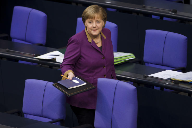 """German Chancellor Angela Merkel arrives for her speech prior to the debate and the voting of the German Parliament Bundestag about a new Greek rescue package in Berlin, Germany, Monday, Feb. 27, 2012. Merkel urged German lawmakers to support the new rescue package on, though she conceded that there is no """"100 percent guarantee"""" it will succeed. (AP Photo/Markus Schreiber)"""