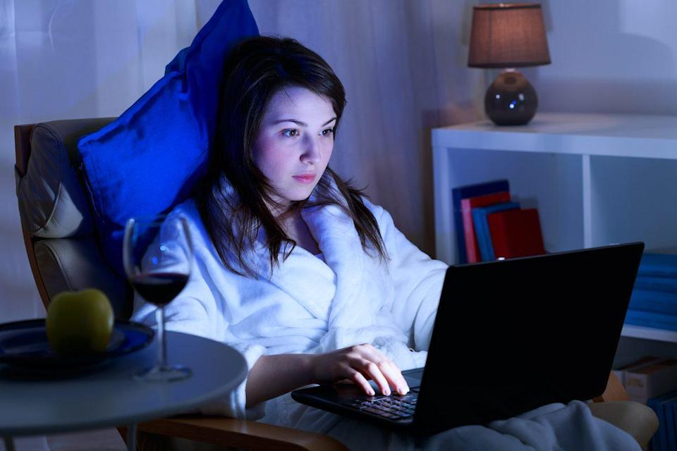 Attractive girl is spending time in front of her laptop