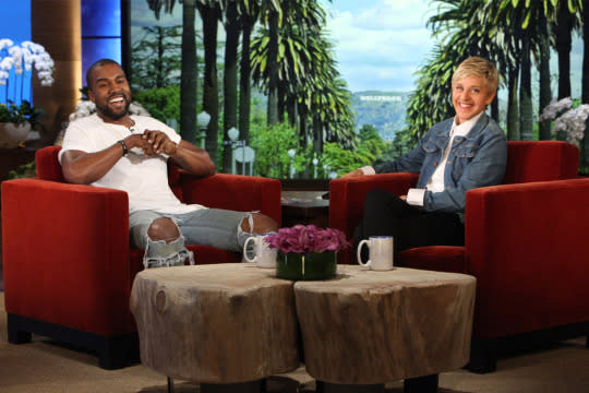 Kanye West sitting down with Ellen DeGeneres on the set of her show.