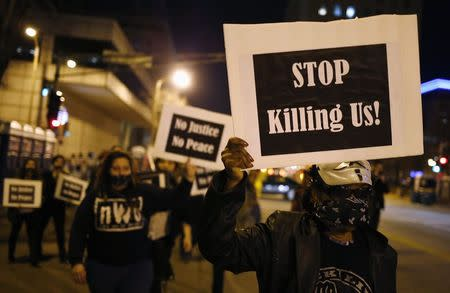 Protesters march through the streets as they demonstrate against what they say is police brutality after the Ferguson shooting of Michael Brown, an unarmed black teenager, by a white police officer, in St. Louis, Missouri, March 14, 2015. REUTERS/Jim Young