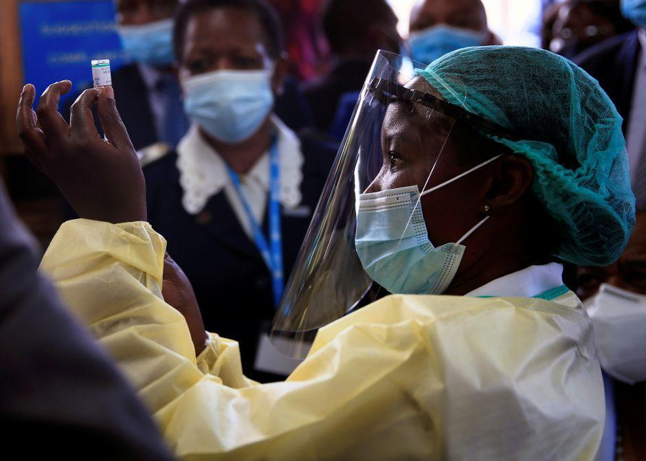A nurse prepares to vaccinate Zimbabwean vice-president Constantino Chiwenga as the country begins vaccinations against Covid-19 on Feb. 18.