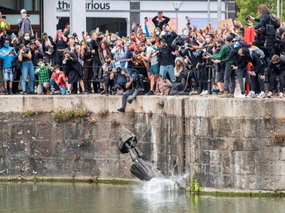 Statue of Bristol slave trader Edward Colston being thrown in the river was one of the 'great cultural events of the Pandemic era' (Reuters)