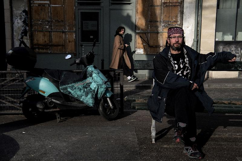 Christian Page has garnered nearly 20,000 Twitter followers for his posts criticizing anti-vagrancy measures and appealing for help for the homeless (AFP Photo/CHRISTOPHE ARCHAMBAULT )