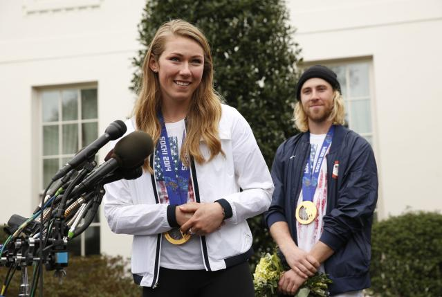 Olympic gold medalists slalom athlete Mikaela Shiffrin (L) and slopestyle snowboarder Sage Kotsenberg talk to reporters at the White House in Washington April 3, 2014. U.S. President Barack Obama and first lady Michelle Obama will honor members of the U.S. teams and delegations from the Sochi Olympics and Paralympics at the White House today. REUTERS/Kevin Lamarque (UNITED STATES - Tags: POLITICS SPORT OLYMPICS)