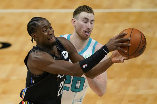 Brooklyn Nets guard Caris LeVert, left, drives around Charlotte Hornets forward Gordon Hayward during the first half of an NBA basketball game in Charlotte, N.C., Sunday, Dec. 27, 2020. (AP Photo/Chris Carlson)