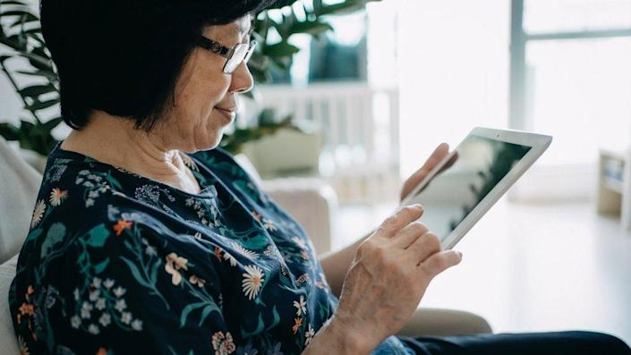 Woman reading off tablet