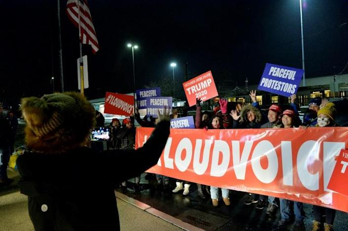 Supporters of Donald Trump gather near Boston, Massachusetts on the evening of January 5, 2021, before leaving by bus for a protest in Washington against Joe Biden's presidential victory