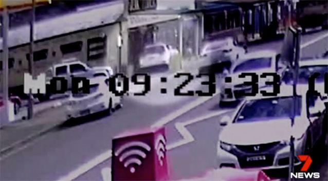 The stolen car jumps onto the footpath in 4WD. Source: 7 News