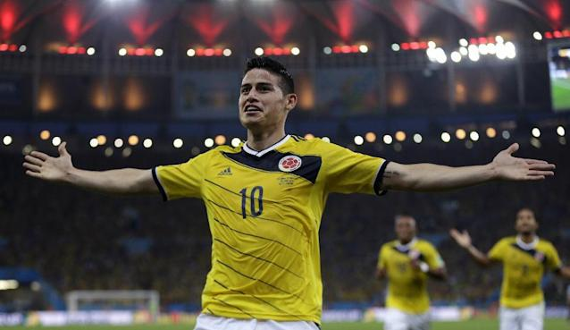 Colombia's James Rodriguez celebrates after scoring the opening goal during the World Cup round of 16 soccer match between Colombia and Uruguay at the Maracana Stadium in Rio de Janeiro, Brazil, Saturday, June 28, 2014. (AP Photo/Natacha Pisarenko)