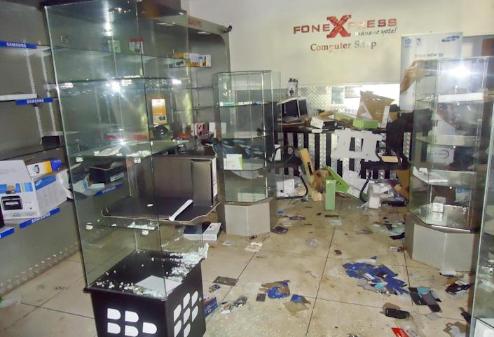 This photo taken Saturday, Sept. 28, 2013 and made available Monday, Sept. 30, 2013, shows the scene inside the FoneXpress computer shop on the ground floor of the Westgate Mall in Nairobi, Kenya. The four-day siege, which included the collapse of part of the mall, left 67 people dead, according to officials. (AP Photo)