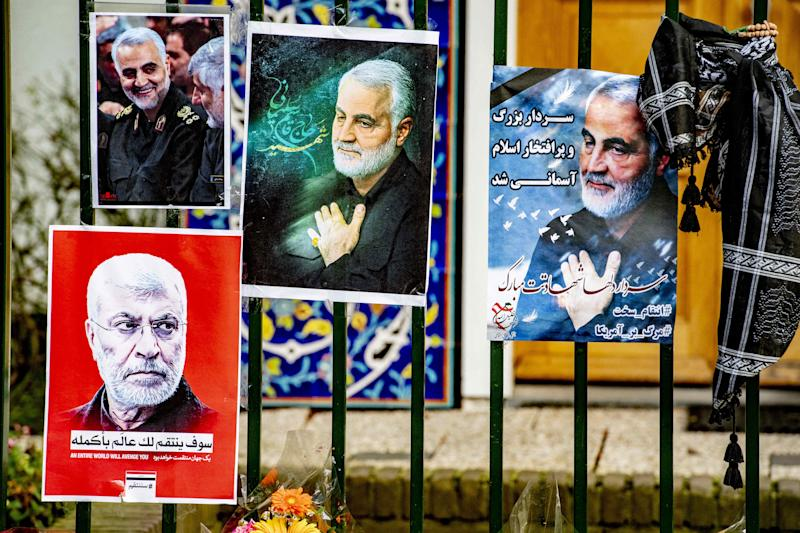 Flowers and posters at the gate of the Iranian embassy in The Hague, Netherlands for Revolutionary Guard General Qassem Soleimani.