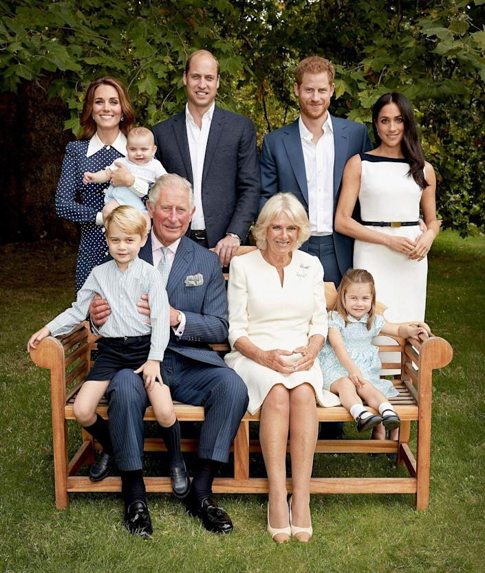"""<p>In honor of Prince Charles's 70th birthday, the royal family released <a href=""""https://www.townandcountrymag.com/society/tradition/g25017880/prince-charles-70-birthday-portraits-royal-family/"""" rel=""""nofollow noopener"""" target=""""_blank"""" data-ylk=""""slk:these family portraits"""" class=""""link rapid-noclick-resp"""">these family portraits </a>taken at Clarence House featuring Charles, Camilla, Will, Kate, Harry, Meghan, and of course George, Charlotte, and Louis. In these photos, George was sitting on his grandfather's lap!</p>"""